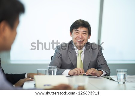Asian Businessman in meeting room - stock photo