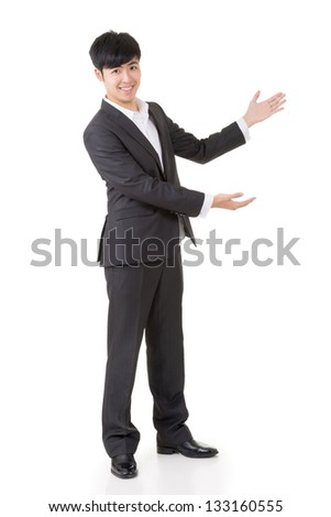 Asian businessman introduce by hand, full length portrait isolated on white background. - stock photo