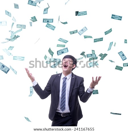 asian businessman is smiling ( or being happy ) with many banknotes flowing in the air on white background - stock photo