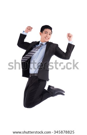Asian businessman jumping. Happy smiling young Asian man show thumb isolated on white background. - stock photo