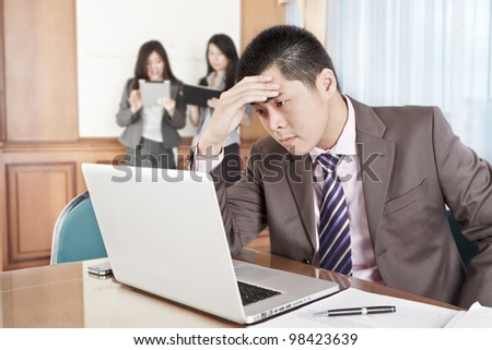 Asian businessman looks so depressed in the office - stock photo