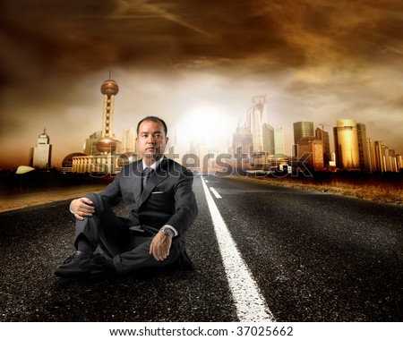 asian businessman on the road for a modern city - stock photo