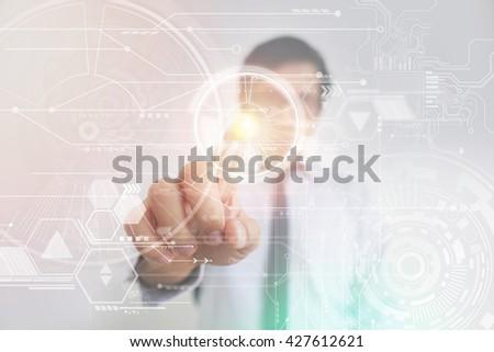 Asian Businessman Pressing High Tech Virtual Screen  - stock photo