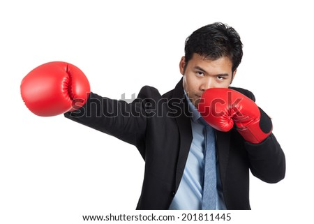 Asian businessman punch with red  boxing glove isolated on white background