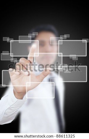 Asian businessman pushing button on the whiteboard. - stock photo