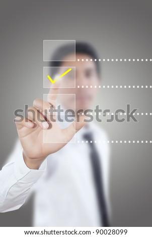 Asian businessman pushing correct choice. - stock photo