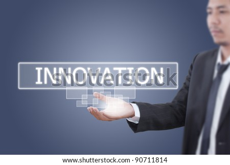 Asian businessman pushing innovation word on a touch screen interface. - stock photo