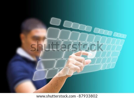 Asian businessman pushing keyboard on the touchscreen - stock photo