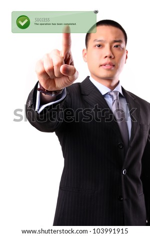 Asian businessman pushing Success word on a touch screen interface. - stock photo