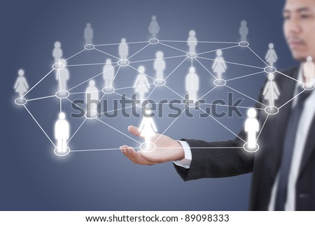 Asian businessman putting people social network.