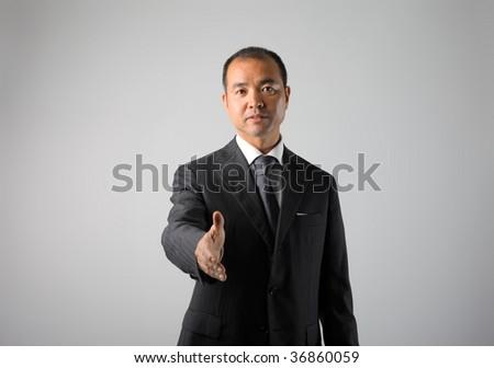 asian businessman sealing a deal - stock photo
