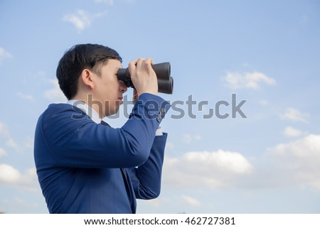 Asian businessman searching and looking for future opportunities  as well as monitoring and watching circumstances