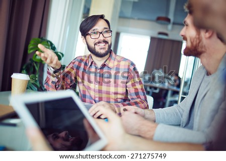 Asian businessman sharing his ideas with colleagues - stock photo