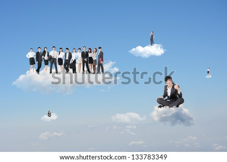 Asian businessman sit on cloud with confident and successful expression and give you an excellent gesture in front of his team. - stock photo