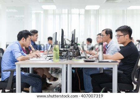 Asian Businessman Sitting At Desk Working Laptop Computer Business People Real Office - stock photo