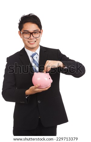 Asian businessman  smile put a coin to a pink piggy bank  isolated on white background