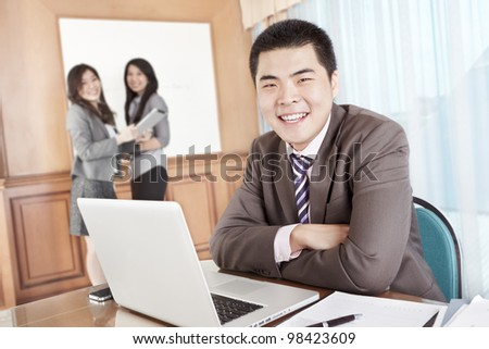 Asian businessman smiling to camera in the office - stock photo