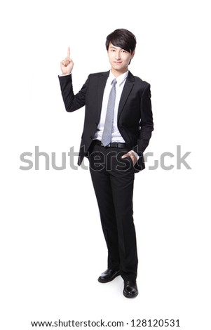 asian businessman standing full length and one finger pointing to up - stock photo