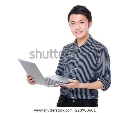 Asian businessman use portable computer - stock photo