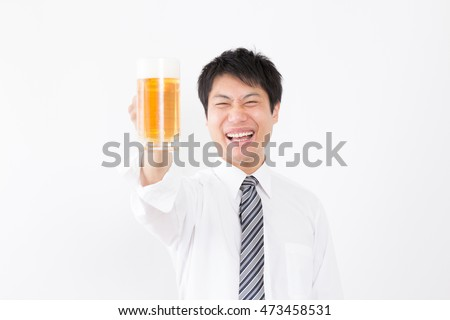 asian businessman who drinks beer.