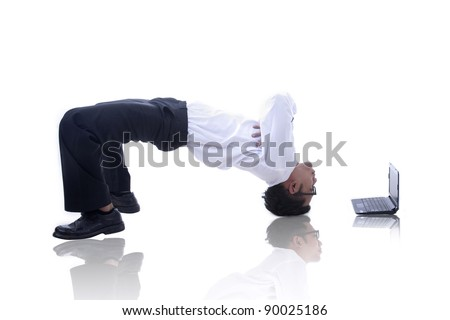 Asian businessman with his acrobatic move and a laptop - stock photo