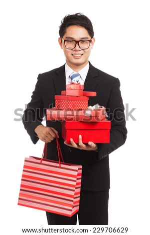 Asian businessman with many gift boxes and shopping bag  isolated on white background