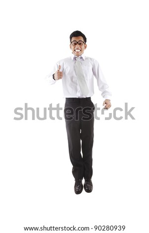 Asian businessman with thumb-up jumping isolated on white