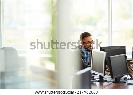 Asian businessman working alone in office - stock photo