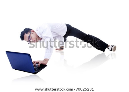Asian businessman working and breakdancing isolated on white - stock photo