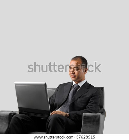 asian businessman working with laptop - stock photo