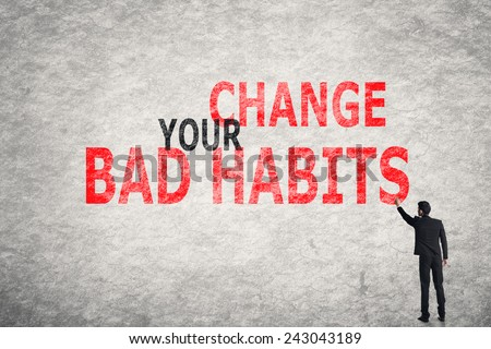 Asian businessman write text on wall, Change Your Bad Habits - stock photo