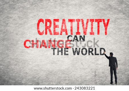 Asian businessman write text on wall, Creativity Can Change The World - stock photo