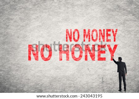 Asian businessman write text on wall, No Money No Honey - stock photo