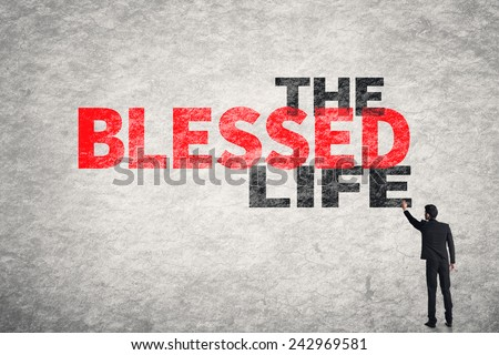 Asian businessman write text on wall, The Blessed Life - stock photo