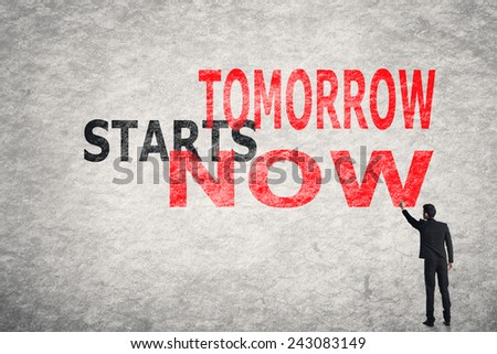 Asian businessman write text on wall, Tomorrow Starts Now - stock photo
