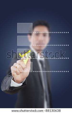 Asian businessman writing correct choice. - stock photo