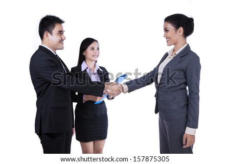 Asian businesspeople handshaking isolated on white background
