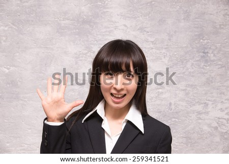 asian businesswoman counting five - stock photo
