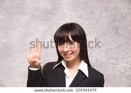 asian businesswoman counting four - stock photo