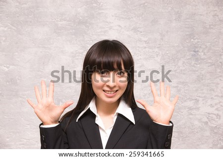 asian businesswoman counting ten - stock photo