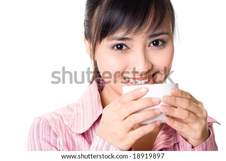 Asian businesswoman drinking a cup of tea