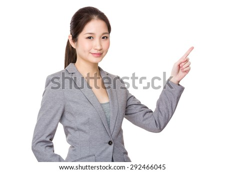 Asian businesswoman finger showing upwards for promoting something