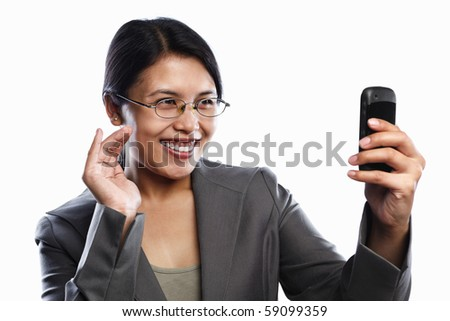 Asian businesswoman happy expression using video call of her cell phone feature, isolted on white background - stock photo