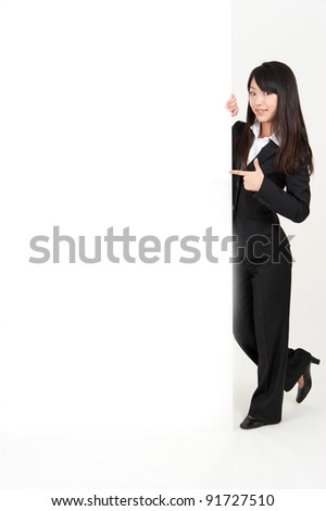 asian businesswoman holding a blank whiteboard isolated on white background - stock photo