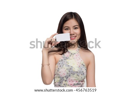 Asian businesswoman holding empty white card , focus of face