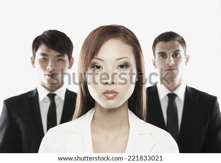 Asian businesswoman in front of businessmen - stock photo