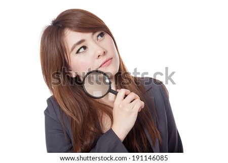 Asian businesswoman is  thinking with magnifying glass looking up isolate on white background - stock photo