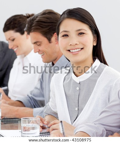 Asian businesswoman looking at the camera in meeting - stock photo