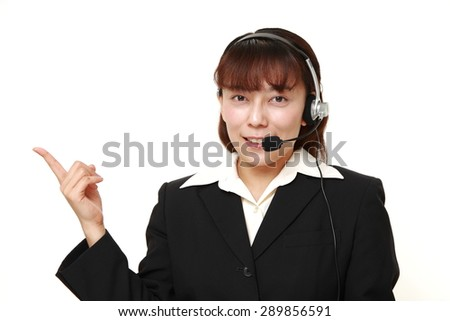 asian businesswoman of call center?presenting - stock photo