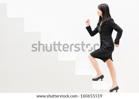 asian businesswoman on white stair - stock photo